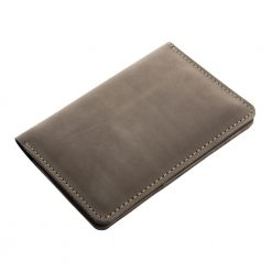 Closed angled view of front of Nomad dark brown leather travel wallet