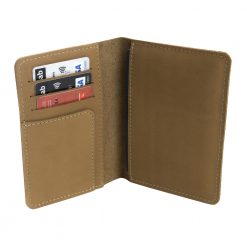Opened view of light brown Nomad leather travel wallet with room for cards ticket and passport
