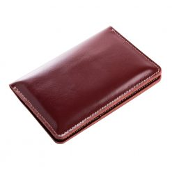 Close angled shot of front side of Nomad leather travel wallet with fine finishing of leather edge shown