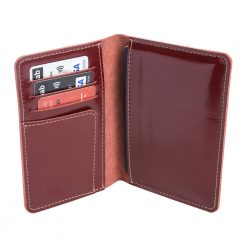 Opened shot of standing maroon Nomad leather travel wallet