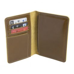 Opened olive leather nomad travel wallet sitting upright