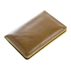 Closed and angled view of olive nomad travel wallet