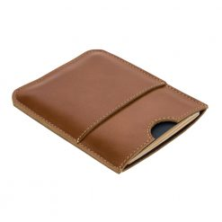 Front side of brown wanderer travel wallet laying on an angle
