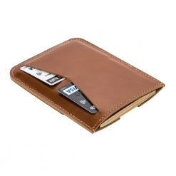 Rear side of wanderer brown travel wallet with passport inserted into slot and cards tucked away