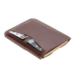 Rear shot showing two credit or debit cards being stored in dark leather holder