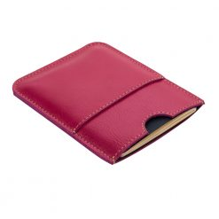Front side of fuschia wanderer passport holder is shown laying on an angle