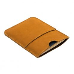 Angled shot of light brown passport holder in stunning soft nubuck leather