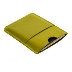 Angled front view of lime Wanderer travel wallet and passport holder