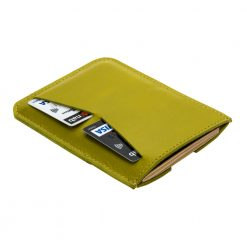 Angled rear view of leather passport holder with two credit card slots