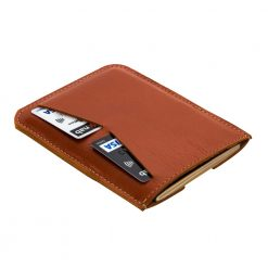 Rear view of stunning orange Wanderer leather travel wallet with credit card slots being used