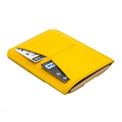 Angled rear view of yellow travel wallet with room for 2 credit cards and passport visible